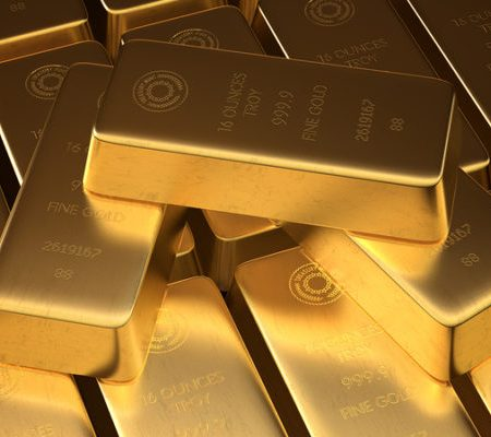 A highly detailed stock photo of Stacked bars of gold bullion.